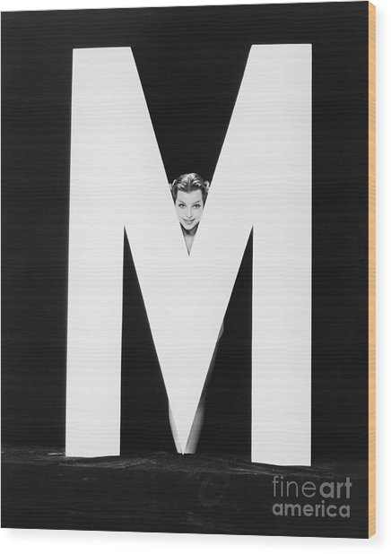 Womans Face With Huge Letter M Wood Print by Everett Collection