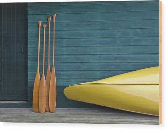 Yellow Canoe And Paddles On Dock Wood Print by Mary Ellen Mcquay