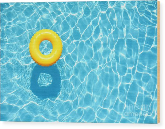Yellow Pool Float, Ring Floating In A Wood Print