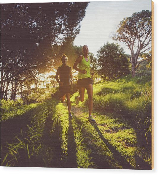 Young Couple Jogging Wood Print
