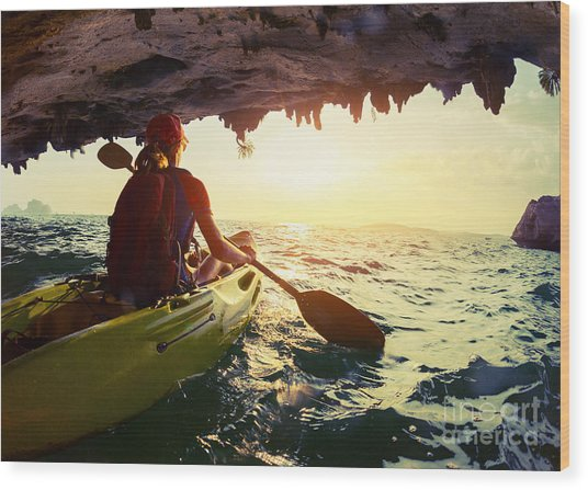 Young Lady Paddling The Kayak From Wood Print