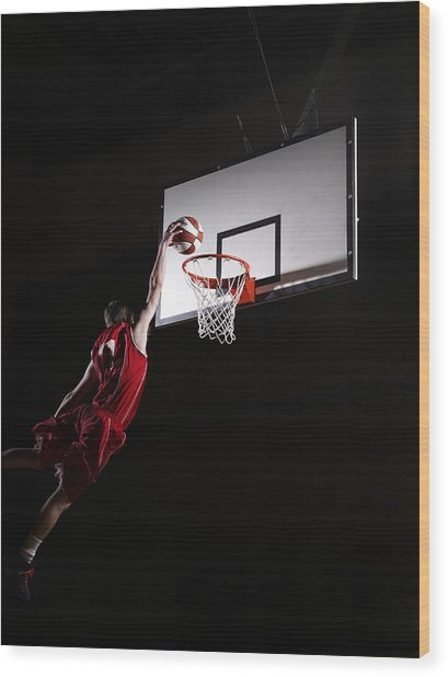 Young Man Attempting To Dunk The Wood Print
