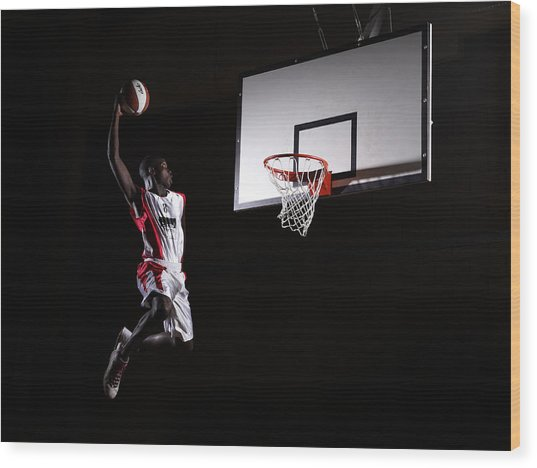 Young Man In The Air About To Dunk The Wood Print