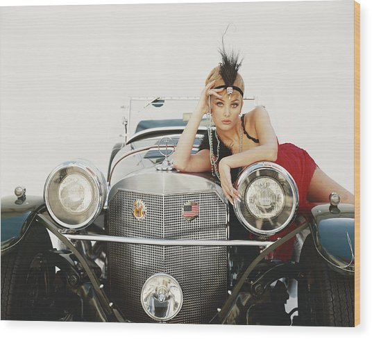 Young Woman Lying On Vintage Car Wood Print by Tom Kelley Archive
