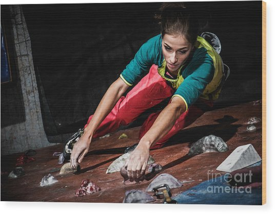 Young Woman Practicing Rock-climbing On Wood Print