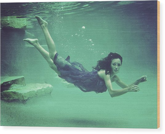 Young Woman Swimming,  Underwater View Wood Print