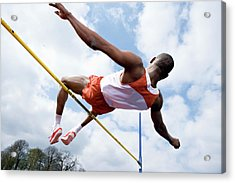 Athlete Performing A High Jump Acrylic Print by Gustoimages/science Photo Library