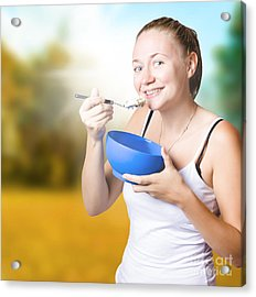 Attractive Young Blond Woman Eating Oatmeal Acrylic Print