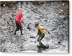 Children Playing In A Muddy Creek Acrylic Print by Ashley Cooper