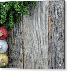 Christmas Pine Needle And Ornaments On A Rustic Wood Background Acrylic Print