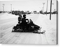 couple on a snowmobile Kamsack Saskatchewan Canada Acrylic Print by Joe Fox