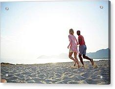 Couple Running On The Beach Acrylic Print by Ruth Jenkinson