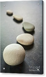 Curving Line Of Grey Pebbles On Dark Background Acrylic Print