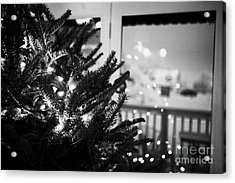 decorated christmas tree looking out of window to snow covered scene in small rural village of Forge Acrylic Print by Joe Fox