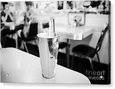fresh strawberry milkshake served in a metal cup in a diner in Saskatchewan Canada Acrylic Print