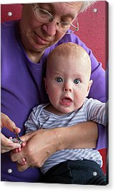 Grandmother Cuts Baby's Fingernails Acrylic Print by Jim West