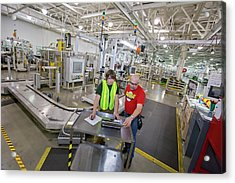 Intern Working At A Car Factory Acrylic Print by Jim West