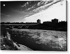 large chunks of floating ice on the south saskatchewan river in winter flowing through downtown Sask Acrylic Print by Joe Fox