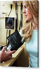 Measuring Blood Pressure Acrylic Print by Saturn Stills