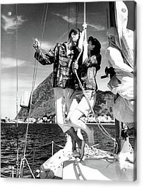 Models Wearing A Bennett Shirts On A Sailboat Acrylic Print by Richard Waite