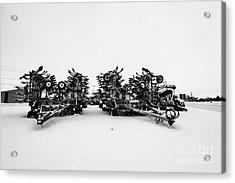new bourgault 5710 air hoe drill covered in snow in winter Kamsack Saskatchewan Canada Acrylic Print by Joe Fox
