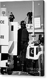 Psni Officers In Protective Riot Gear At Landrovers And Snipers On Crumlin Road At Ardoyne Shops Bel Acrylic Print by Joe Fox