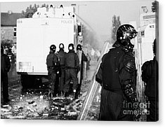 Psni Riot Officers Behind Water Canon During Rioting On Crumlin Road At Ardoyne Shops Belfast 12th J Acrylic Print by Joe Fox