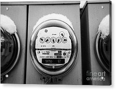 snow covered electricity meters in Saskatoon Saskatchewan Canada Acrylic Print by Joe Fox