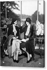 Two Women Talking Acrylic Print by Underwood Archives