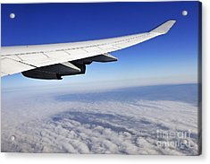 Wing Of Flying Airplane Above Clouds Acrylic Print by Sami Sarkis