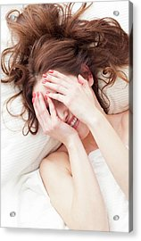 Woman Covering Face With Hands Acrylic Print by Ian Hooton