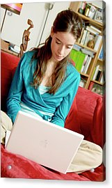 Woman Using A Laptop Computer Acrylic Print by Aj Photo/science Photo Library