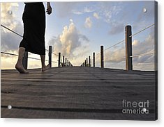 Woman Walking On Wooden Jetty At Sunrise Acrylic Print by Sami Sarkis