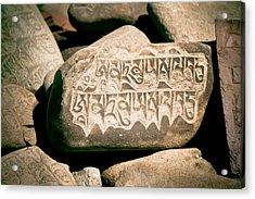 writing on the Tibetan language and Sanskrit at stone Acrylic Print by Raimond Klavins