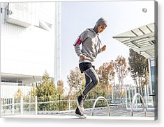 Young Muslim Woman Ready To Running In The City Acrylic Print by LeoPatrizi