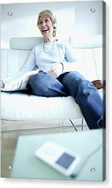 Woman Listening To Music Acrylic Print by Ian Hooton/science Photo Library