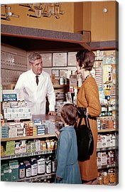1960s Mother And Daughter In Pharmacy Acrylic Print