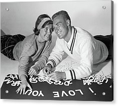 1960s Smiling Collegiate Couple Lying Acrylic Print