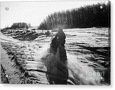 man on snowmobile crossing frozen fields in rural Forget Saskatchewan Canada Acrylic Print