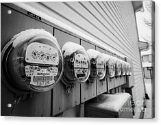 snow covered electricity meters in Saskatoon Saskatchewan Canada Acrylic Print by Joe Fox
