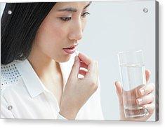 Woman Taking Painkiller Acrylic Print by Ian Hooton