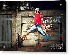 Young Man Jumping On Grunge Wall Acrylic Print by Michal Bednarek