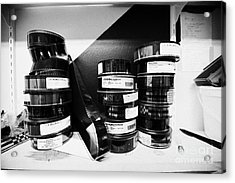 35mm Cinema Films On Shelf In Old Cinema Projection Room Biggar Saskatchewan Canada Acrylic Print by Joe Fox