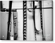 35mm Cinema Film Intro Hanging In Old Cinema Projection Room Biggar Saskatchewan Canada Acrylic Print by Joe Fox