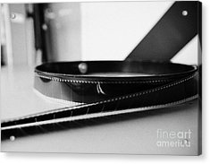 35mm Cinema Film Unwound On Spool In Old Cinema Projection Room Biggar Saskatchewan Canada Acrylic Print by Joe Fox