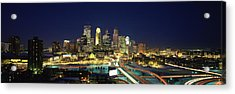 Buildings Lit Up At Night In A City Acrylic Print by Panoramic Images