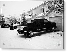 4x4 Pickup Trucks Parked In Driveway In Snow Covered Residential Street During Winter Saskatoon Sask Acrylic Print by Joe Fox