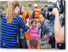 Syrian Refugees Arriving On Greek Island Acrylic Print