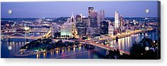 Buildings In A City Lit Up At Dusk Acrylic Print by Panoramic Images