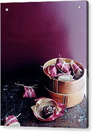 A Bamboo Steamer With Paper Packages Acrylic Print by Romulo Yanes